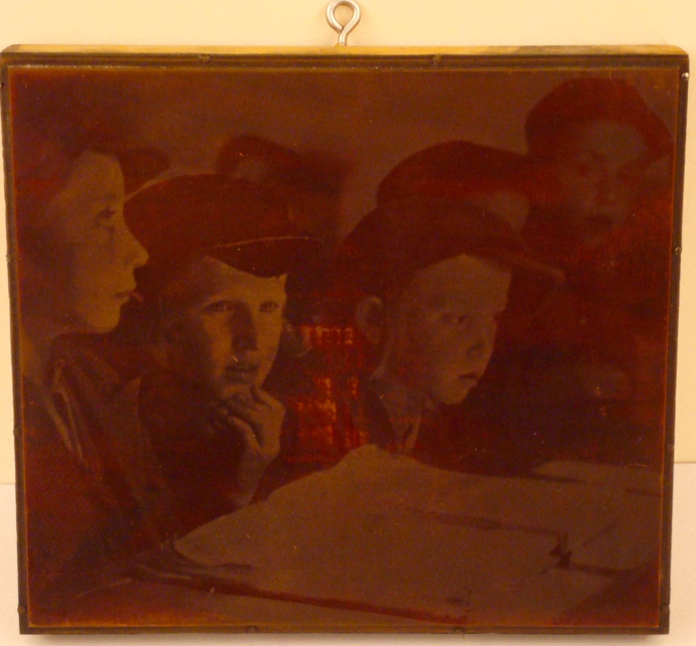 Photoplate featuring 1938 Roman Vishniac photograph depicting young boys sitting around a large book